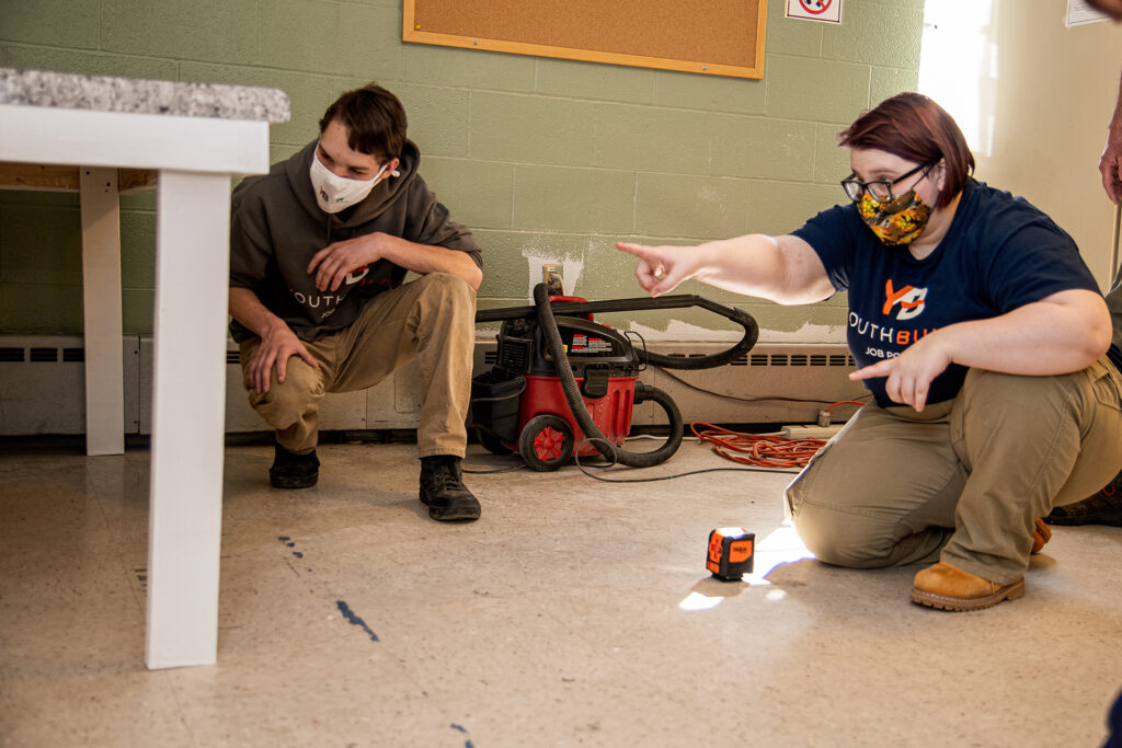 students work together to build a desk