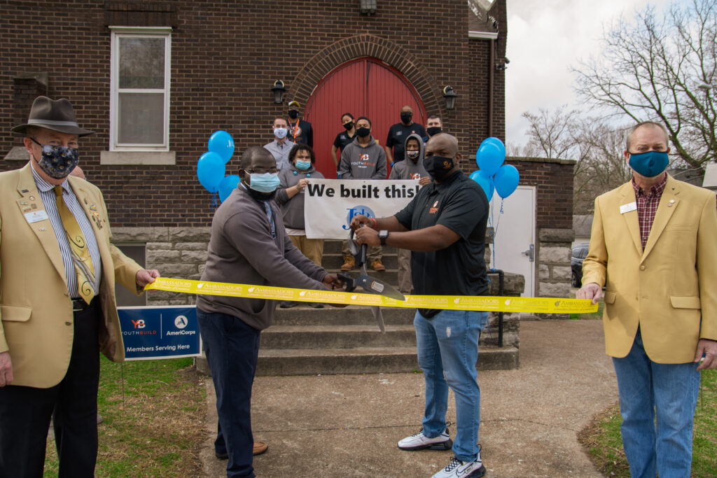 Staff and Community gather for a ribbon cutting in front of the church